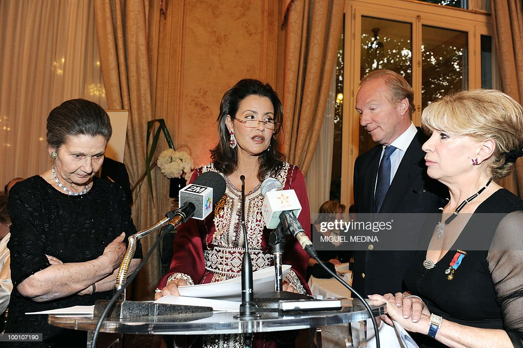 Princess Lalla Meryem of Morocco (C) delivers a speech after receiving the 'World Women leaders' prize from French academician and former Health Minister Simone Veil (L), for her work to improve women's conditions, under the look of French Interior Minister Brice Hortefeux (2nd R), on May 20, 2010 in Paris.