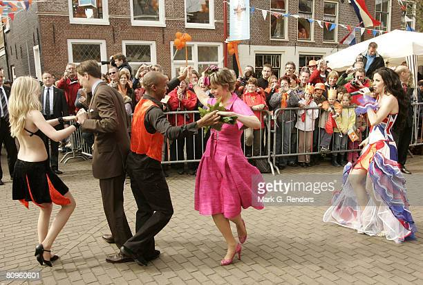 Princess Laurentien and Prince Constantijnl from the Dutch Royal Family dance on the streets on Queensday April 30 2008 in Makkum The Netherlands