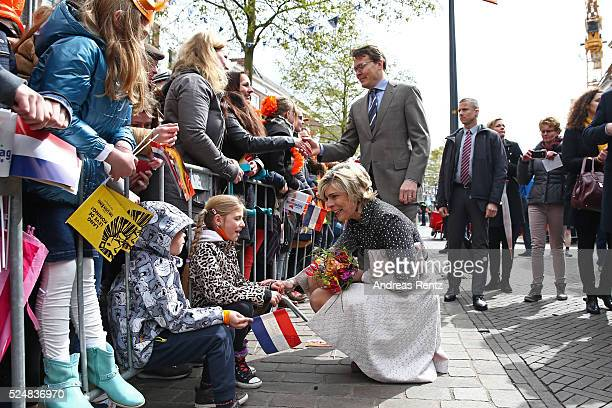Princess Laurentien of The Netherlands and Prince Constantijn of The Netherlands greet spectators during King's Day the celebration of the birthday...