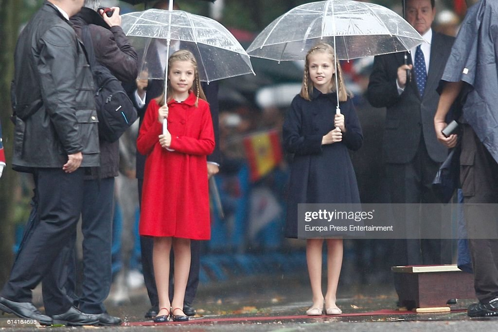 Princess Leonor (R) and Princess Sofia attend the National Day Military Parade 2016 on October 12, 2016 in Madrid, Spain.
