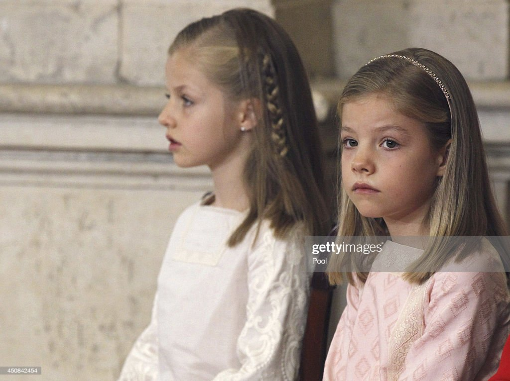 Princess Leonor of Spain and Princess Sofia of Spain attend the official abdication ceremony at the Royal Palace on June 18, 2014 in Madrid, Spain. King Juan Carlos of Spain's abdication takes effect at midnight local time.