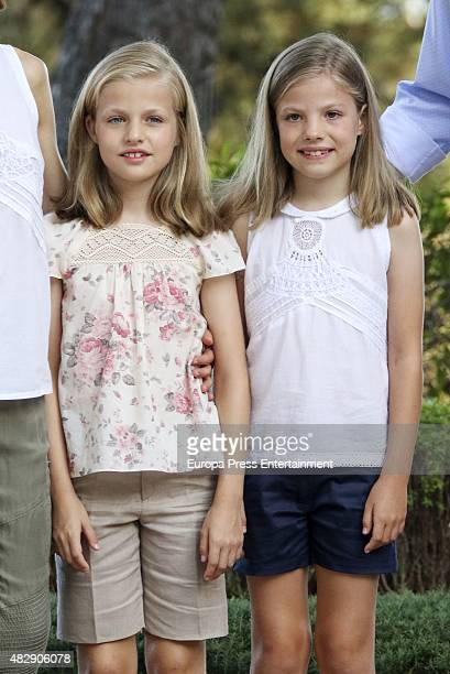 Princess Leonor of Spain and Princess Sofia of Spain pose for the photographers at the Marivent Palace on August 3 2015 in Palma de Mallorca Spain