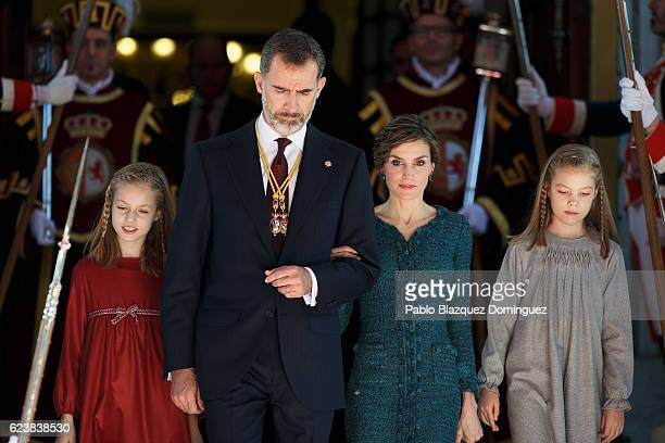 Princess Leonor of Spain King Felipe VI of Spain Queen Letizia of Spain and Princess Sofia of Spain prepare to watch the military parade at the end...