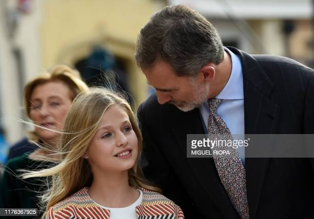Princess Leonor of Spain listens to her father king Felipe VI outside the Oviedo cathedral on October 17, 2019 on the eve of the Princess of Asturias...