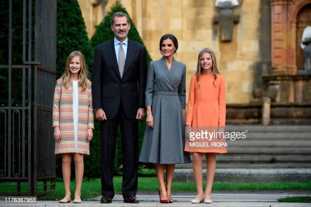 Princess Leonor of Spain poses with her parents king Felipe VI and queen Letizia, and sister princess Sofia outside the Oviedo cathedral on October...