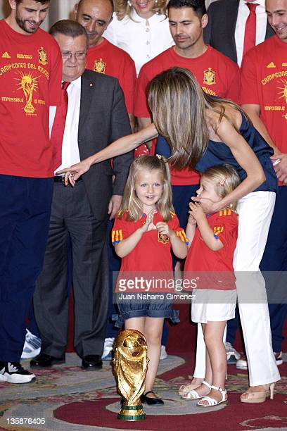 Princess Leonor of Spain Princess Sofia of Spain and Princes Letizia of Spain stand in front of the World Cup as King Juan Carlos of Spain receives...