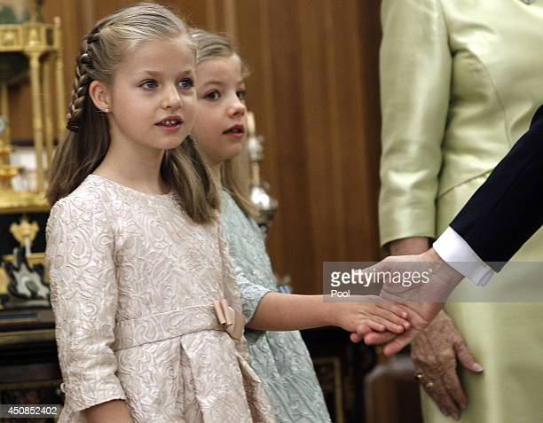 Princess Leonor Princess of Asturias and Princess Sofia attend a ceremony in the Hearing Room of Zarzuela Palace prior to the King's official...