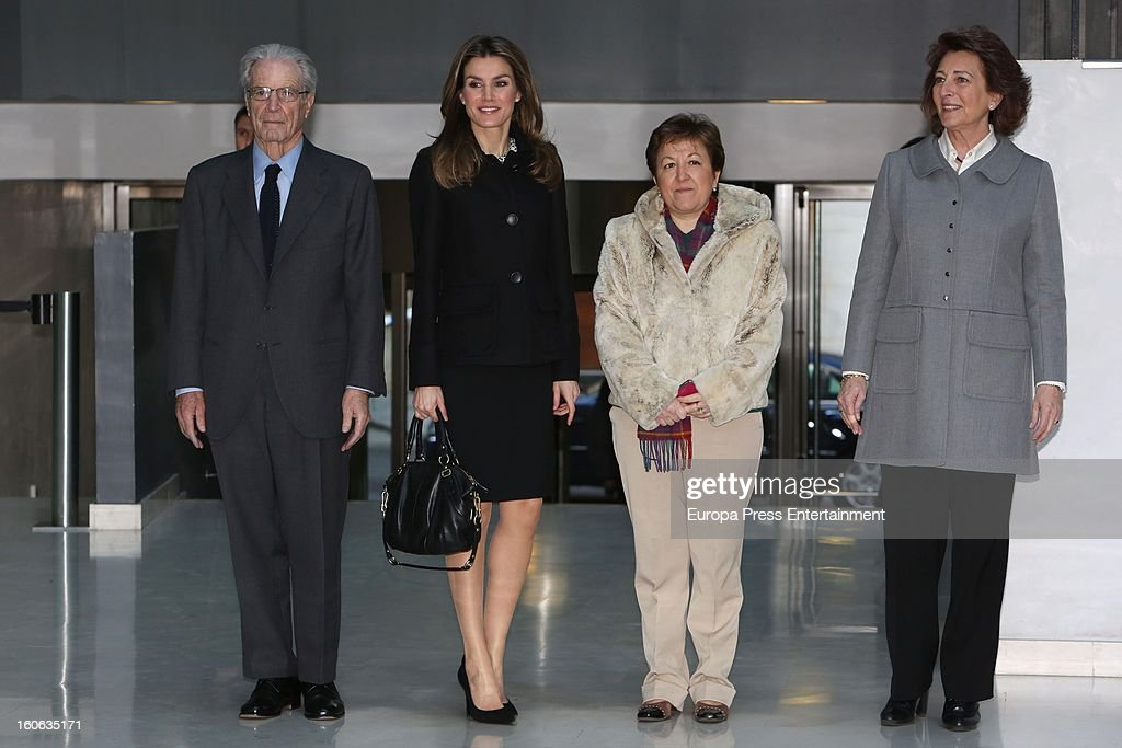 Princess Letizia of Spain (2L) and Antonio Garrigues Walker (L) arrive to a forum organized by Cancer Spanish Association on February 4, 2013 in Madrid, Spain.