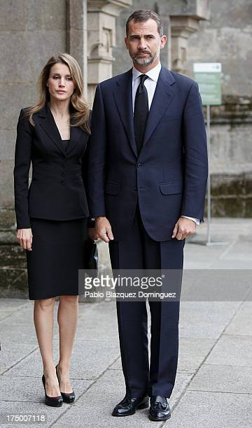 Princess Letizia of Spain and Prince Felipe of Spain arrive at Santiago de Compostela Cathedral prior to a memorial Mass for the victims of the...