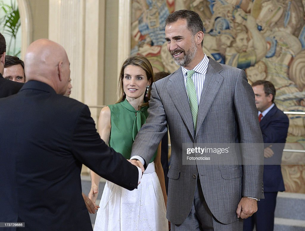 Princess Letizia of Spain (L) and Prince Felipe of Spain (R) attend audiences at Zarzuela Palace on July 17, 2013 in Madrid, Spain.