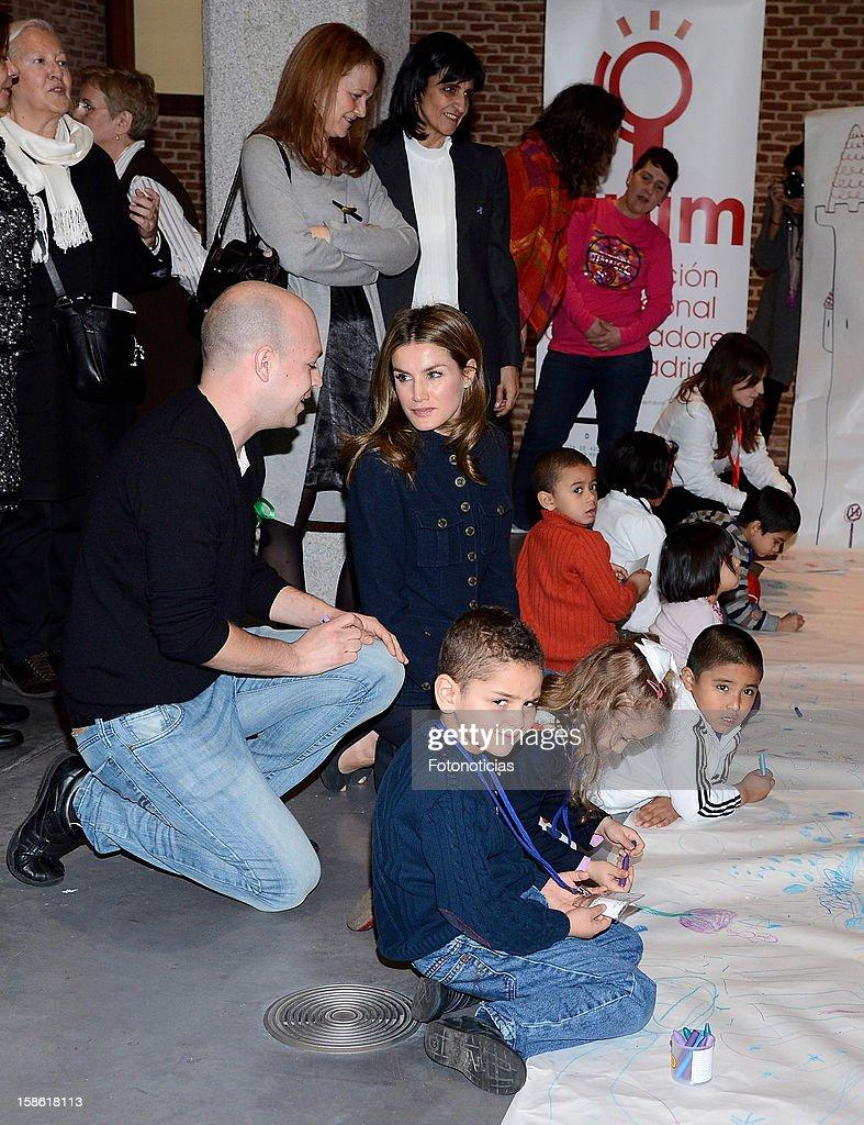 Princess Letizia of Spain attends 'A Que Sabe Este Libro' exhibition at Cuartel Conde Duque on December 21, 2012 in Madrid, Spain.