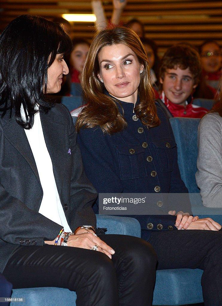 Princess Letizia of Spain (R) attends 'A Que Sabe Este Libro' exhibition at Cuartel Conde Duque on December 21, 2012 in Madrid, Spain.