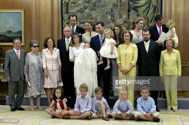 Princess Letizia of Spain holds her daughter Princess Sofia with members of the Spanish Royal family during the baptism of Princess Sofia on July 15,...