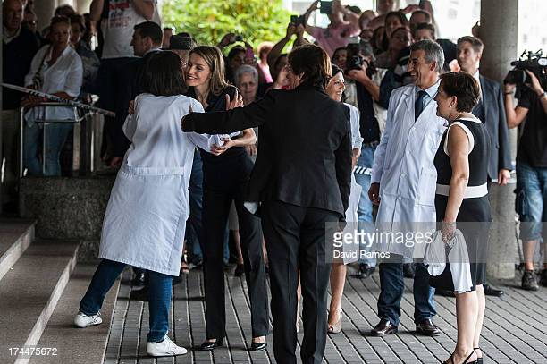 Princess Letizia of Spain hugs a doctor as she visits Clinico Hospital after a train crash killed 78 on July 26 2013 in Santiago de Compostela Spain...