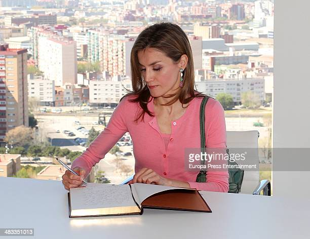 Princess Letizia of Spain signs the book as she attends the opening of the new headquarters of Puig firm in its 20th anniversary on April 7 2014 in...