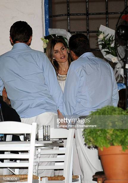 Princess Letizia talking to Prince Nikolaos during a dinner for young people at a small greek restaurant after the prewedding reception at the...