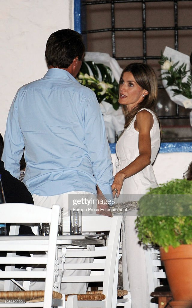 Princess Letizia talking to Prince Nikolaos during a dinner for young people at a small greek restaurant after the pre-wedding reception at the Poseidon Hotel on August 24 2010 in Spetses, Greece. The small greek Island, three hours from Athens, is gearing up for the Royal Wedding of Prince Nikolaos of Greece and Tatiana Blatnik on August 25. Royals from all over Europe and the world are expected to attend the ceremony. Prince Nikolaos is the second son of King Constantine and Queen Anne-Marie while Tatiana is an events planner for Diane Von Furstenburg in London. Many of the VIP guests are expected to stay in the Poseidon Hotel in the town centre.