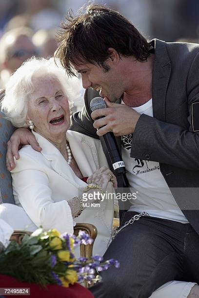Princess Lilian and singer Martin Stenmark are seen at a concert during celebrations for Crown Princess Victoria's 28th birthday on July 14, 2005 in...