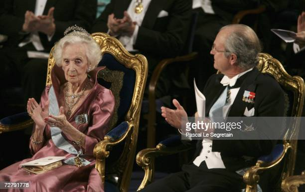 Princess Lilian of Sweden and King Carl XVI Gustaf of Sweden attend the Nobel Foundation Prize 2006 at the Concert Hall on December 10, 2006 in...