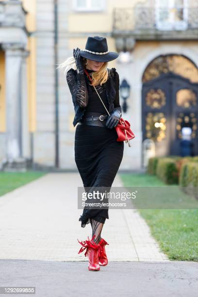 Princess Lilly zu Sayn-Wittgenstein-Berleburg wearing a long black dress with lace details by Ralph Lauren, a red bag with gold details by Bulgari, a...