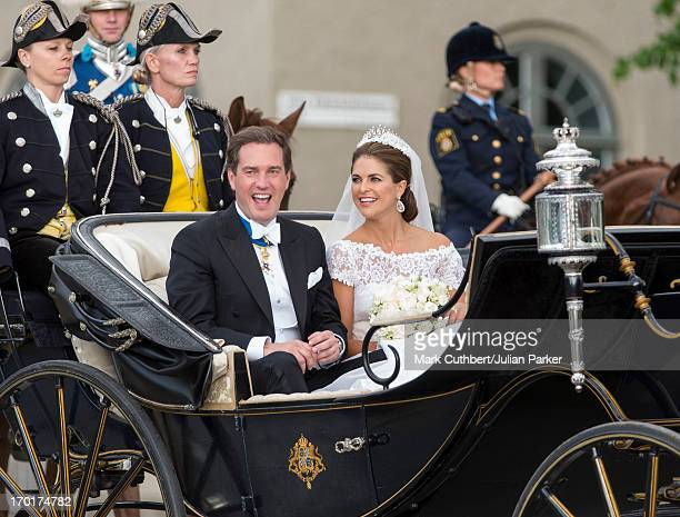 Princess Madeleine of Sweden and Christopher O'Neill arrive by horse drawn carriage to board a boat for the banquet at Drottningholm Palace after...
