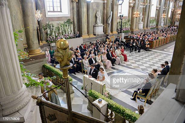 Princess Madeleine of Sweden and Christopher O'Neill kneel during the wedding ceremony of Princess Madeleine of Sweden and Christopher O'Neill hosted...