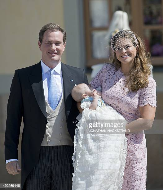 Princess Madeleine of Sweden and her husband Christopher O'Neill hold their daughter, Princess Leonore on June 8, 2014 after her christening at the...