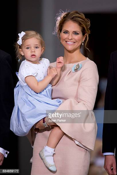 Princess Madeleine of Sweden and Princess Leonore of Sweden attend the christening of Prince Oscar of Sweden at the Royal Palace in Stockholm on May...