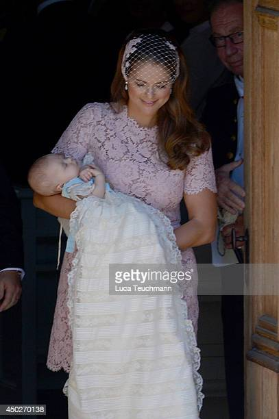 Princess Madeleine of Sweden carries her daughter Princess Leonore Duchess of Gotland after her Royal Christening at Drottningholm Palace Chapel on...