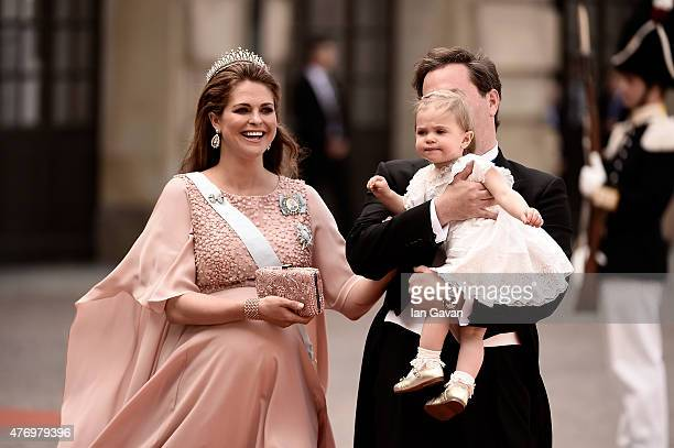 Princess Madeleine of Sweden, her husband Christopher O'Neill and their daughter Princess Leonore attend the royal wedding of Prince Carl Philip of...