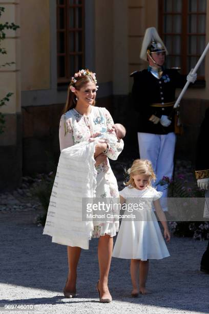 Princess Madeleine of Sweden holding Princess Adrienne of Sweden and Princess Eleonore of Sweden leave after the christening of Princess Adrienne of...