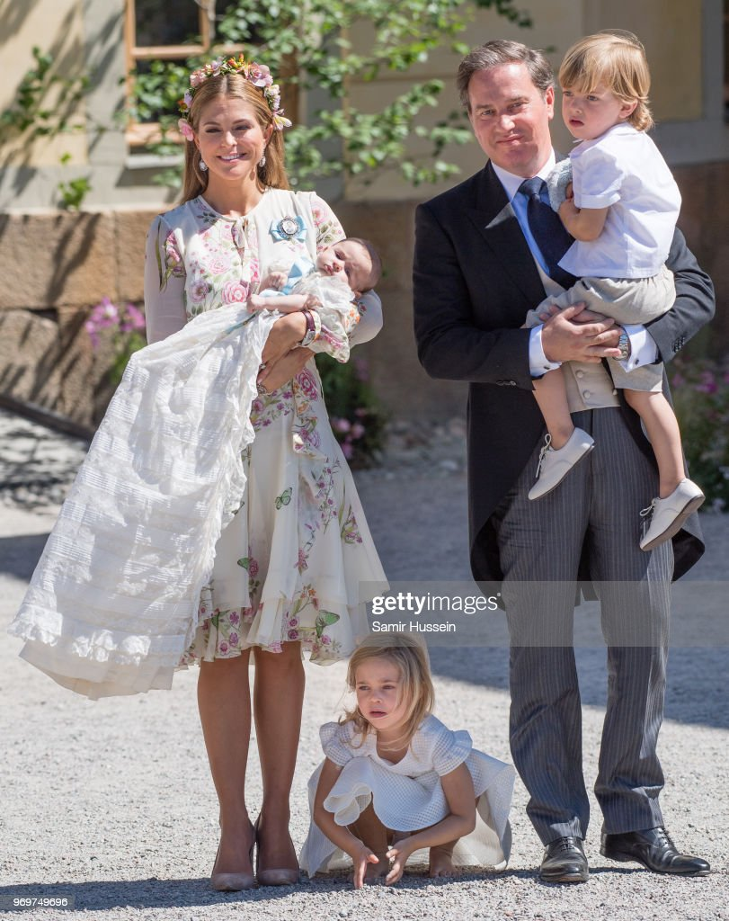 Princess Madeleine of Sweden, holding Princess Adrienne of Sweden, Princess Eleonore of Sweden and Christopher O'Neill holding Prince Nicolas of Sweden attend the christening of Princess Adrienne of Sweden at Drottningholm Palace Chapel on June 8, 2018 in Stockholm, Sweden.
