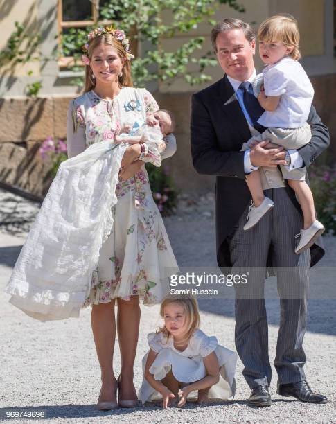 Princess Madeleine of Sweden, holding Princess Adrienne of Sweden, Princess Eleonore of Sweden and Christopher O'Neill holding Prince Nicolas of...