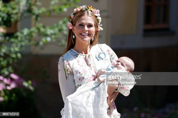 Princess Madeleine of Sweden holding Princesse Adrienne of Sweden, leaves the christening of Princess Adrienne of Sweden at Drottningholm Palace...