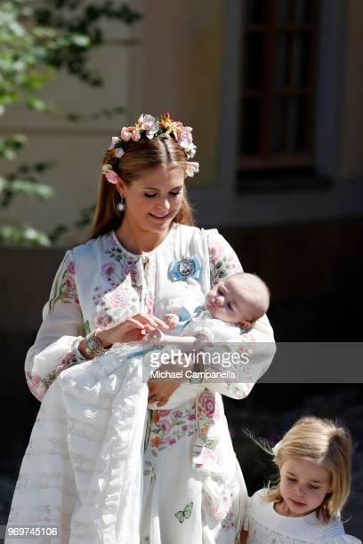Princess Madeleine of Sweden holding Princesse Adrienne of Sweden leaves the christening of Princess Adrienne of Sweden at Drottningholm Palace...