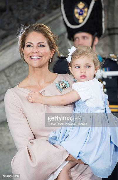 Princess Madeleine of Sweden holds Princess Leonore as they leave the christening of Prince Oscar at the Royal Chapel in Stockholm on May 27 2016 /...
