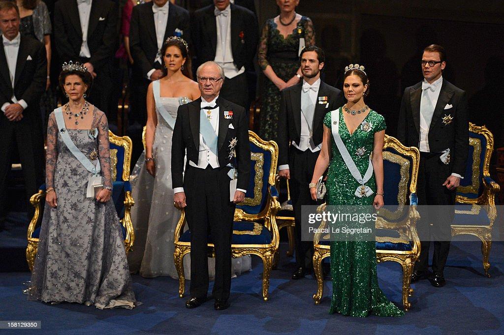 Princess Madeleine of Sweden, Prince Carl Philip of Sweden and Prince Daniel of Sweden, and (front row, L-R) Queen Silvia of Sweden, King Carl XVI Gustaf of Sweden and Crown Princess Victoria of Sweden attend the Nobel Prize Ceremony at Concert Hall on December 10, 2012 in Stockholm, Sweden.