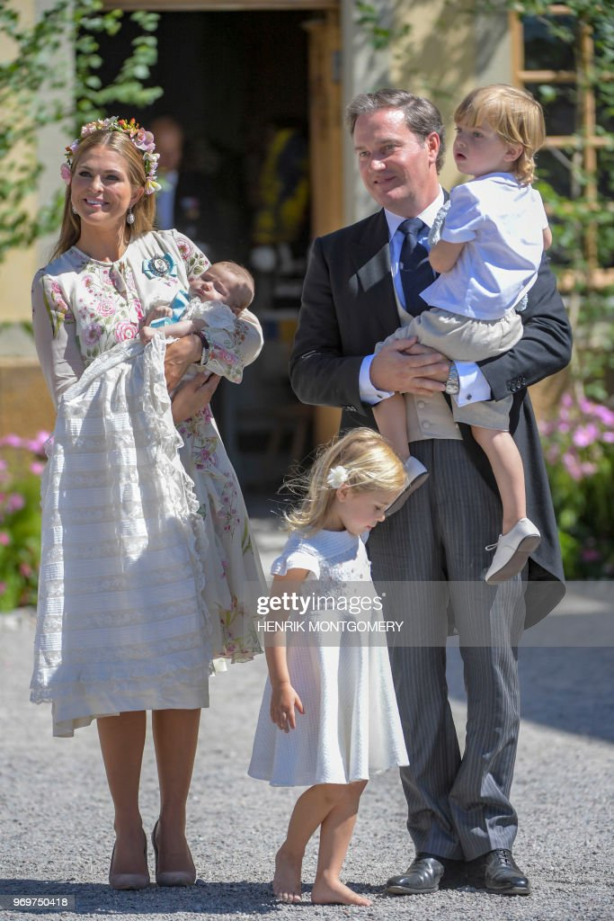 Princess Madeleine of Sweden, princess Adrienne of Sweden, princess Leonore of Sweden, Mr Christopher O'Neill and prince Nicolas of Sweden are pictured after Princess Adrienne's christening ceremony in Drottningholm Palace Chapel in Stockholm, Sweden on June 8, 2018. - Princess Adrienne is princess Madeleine's and Mr Christopher O'Neill's third child. (Photo by Henrik MONTGOMERY / various sources / AFP) / Sweden OUT