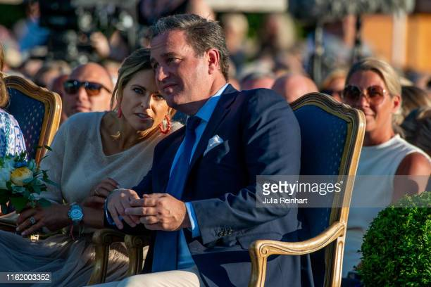 Princess Madeleine of Sweden speaks to her husband Chris O'Neill during The Crown Princess Victoria of Sweden's 42nd birthday celebrations on July 14...
