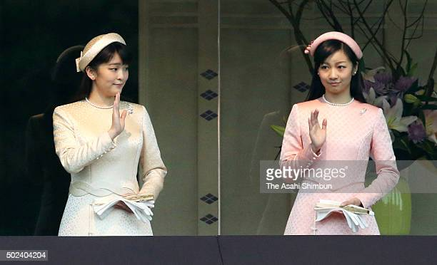 Princess Mako and Princess Kako of Akishino wave to wellwishers as Emperor Akihito celebrates his 82nd birthday at the Imperial Palace on December 23...