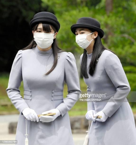 Princess Mako and Princess Kako of Akishino wearing face masks visit the mausoleum of Empress Kojun at the Musashino Imperial Graveyard on June 16,...