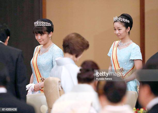 Princess Mako and Princess Kako the granddaughters of Emperor Akihito and Empress Michiko attend a banquet at the Imperial Palace in Tokyo on Oct 11...