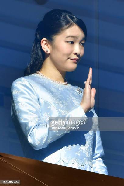Princess Mako of Akishino greets wellwishers from a balcony at the Imperial Palace on January 2 2018 in Tokyo Japan