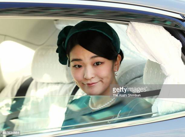 Princess Mako of Akishino is seen on arrival to attend a greeting session at the Imperial Palace celebrating Emperor Akihito's 84th birthday on...