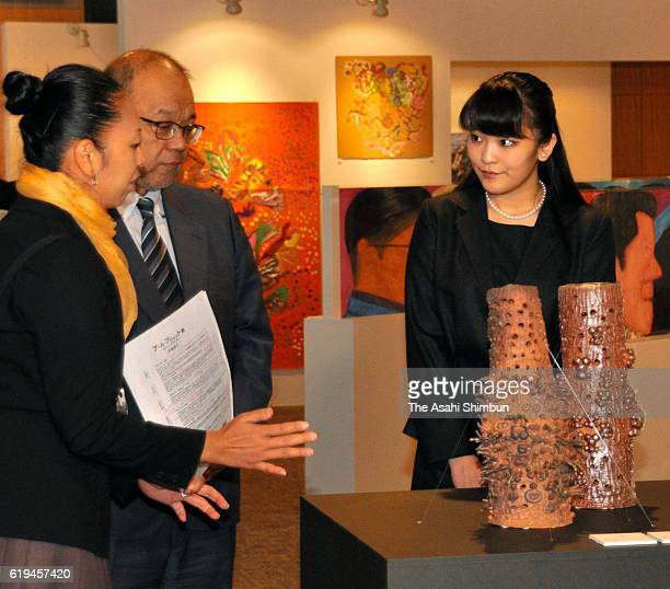 Princess Mako of Akishino listens to an explanation during her visit to an art exhibition of handicapped people at Yonago Convention Center on...