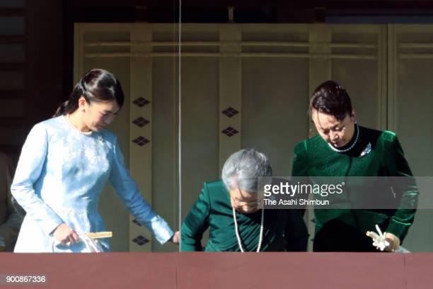 Princess Mako of Akishino Princess Yuriko of Mikasa and Princess Nobuko of Mikasa are seen at a balcony at the Imperial Palace on January 2 2018 in...