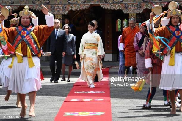 Princess Mako of Akishino walks to the office of King Jigme Khesar Namgyel Wangchuck of Bhutan prior to their meeting at Tashichho Dzong on June 2...