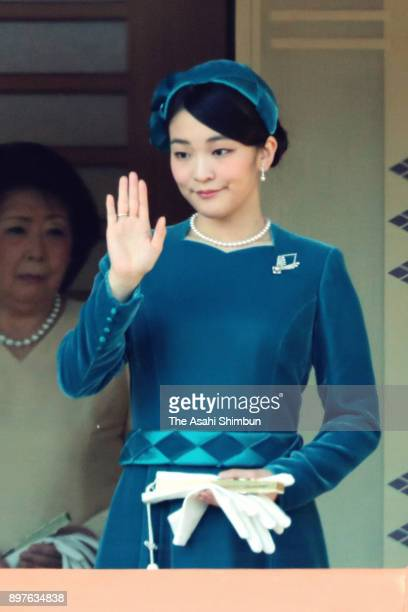 Princess Mako of Akishino waves to wellwishers during a session celebrating Emperor Akihito's 84th birthday at the Imperial Palace on December 23...