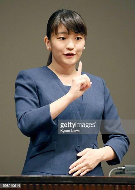 Princess Mako the eldest daughter of Prince Akishino and Princess Kiko uses sign language as she addresses an opening ceremony for a national high...