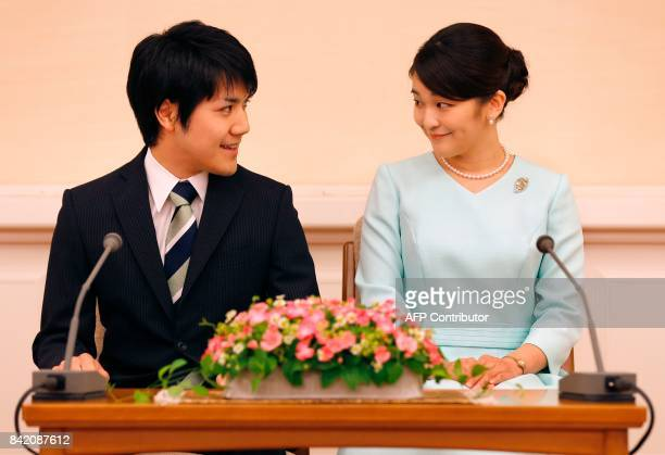 Princess Mako the eldest daughter of Prince Akishino and Princess Kiko and her fiancee Kei Komuro smile during a press conference to announce their...